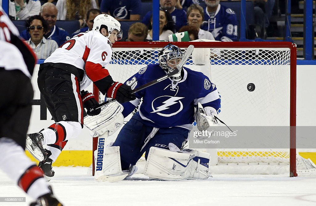 Bobby Ryan #6 of the Ottawa Senators and goalie Ben Bishop #30 of the Tampa Bay Lightning look at a rebound at the Tampa Bay Times Forum on December 5, 2013 in Tampa, Florida.