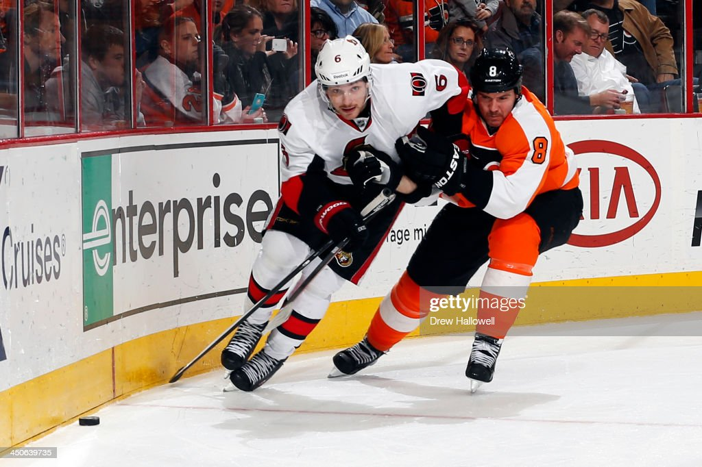 <a gi-track='captionPersonalityLinkClicked' href=/galleries/search?phrase=Bobby+Ryan+-+Ice+Hockey+Player&family=editorial&specificpeople=877359 ng-click='$event.stopPropagation()'>Bobby Ryan</a> #6 of the Ottawa Senators and <a gi-track='captionPersonalityLinkClicked' href=/galleries/search?phrase=Nicklas+Grossman&family=editorial&specificpeople=2284863 ng-click='$event.stopPropagation()'>Nicklas Grossman</a>n #8 of the Philadelphia Flyers battle for the puck at the Wells Fargo Center on November 19, 2013 in Philadelphia, Pennsylvania. The Flyers won 5-2.