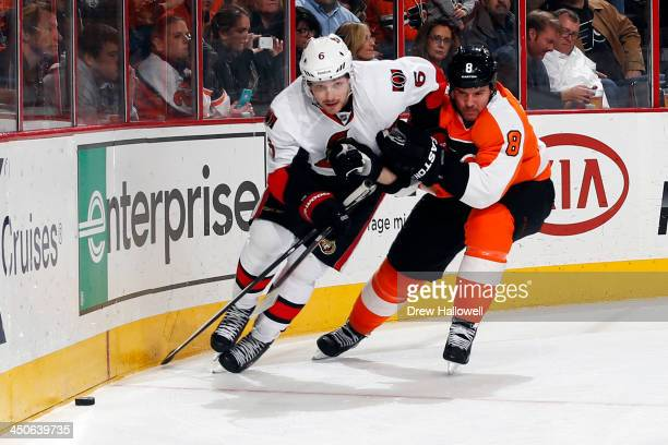 Bobby Ryan of the Ottawa Senators and Nicklas Grossmann of the Philadelphia Flyers battle for the puck at the Wells Fargo Center on November 19 2013...