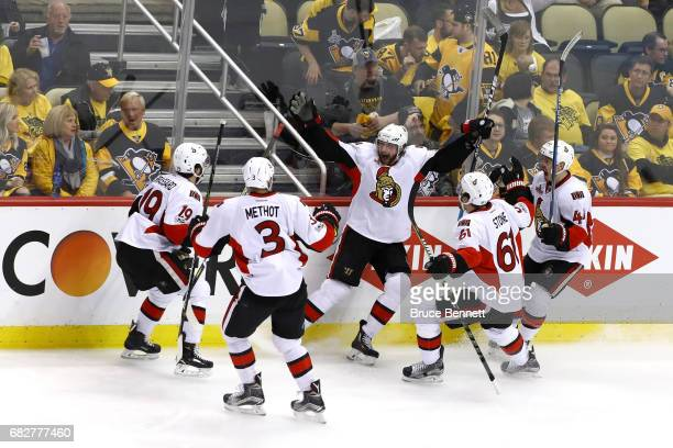 Bobby Ryan of the Ottawa Senators celebrates after scoring a goal against MarcAndre Fleury of the Pittsburgh Penguins in overtime of Game One of the...