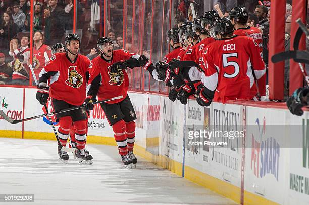 Bobby Ryan of the Ottawa Senators celebrates his second period goal against the San Jose Sharks with Marc Methot and other teammates at the players'...