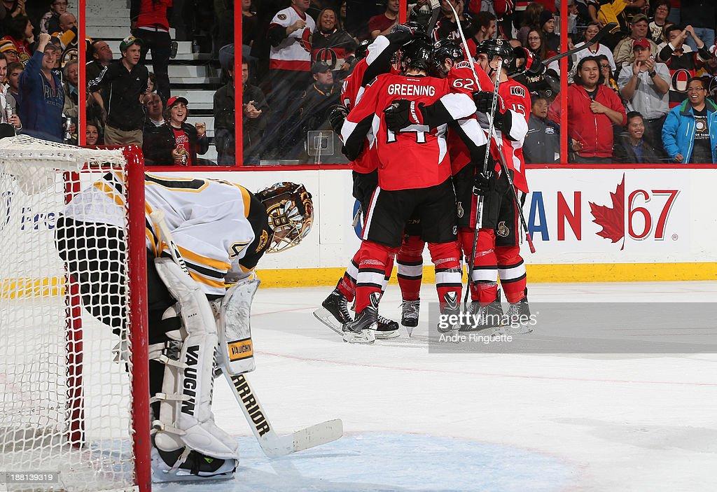 Bobby Ryan of the Ottawa Senators celebrates his third period goal against Tuukka Rask of the Boston Bruins with teammates Colin Greening Eric Gryba...