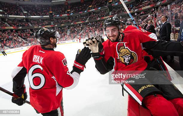 Bobby Ryan of the Ottawa Senators celebrates his third period goal against the Detroit Red Wings with teammate Mika Zibanejad at the players' bench...