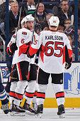 Bobby Ryan of the Ottawa Senators celebrates his third period goal with teammates Kyle Turris and Erik Karlsson of the Ottawa Senators during a game...
