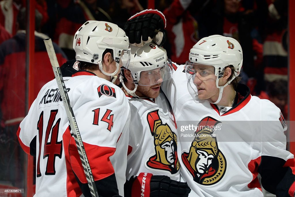 <a gi-track='captionPersonalityLinkClicked' href=/galleries/search?phrase=Bobby+Ryan+-+Ice+Hockey+Player&family=editorial&specificpeople=877359 ng-click='$event.stopPropagation()'>Bobby Ryan</a> #6 of the Ottawa Senators celebrates with <a gi-track='captionPersonalityLinkClicked' href=/galleries/search?phrase=Colin+Greening&family=editorial&specificpeople=7183741 ng-click='$event.stopPropagation()'>Colin Greening</a> #14 and <a gi-track='captionPersonalityLinkClicked' href=/galleries/search?phrase=Kyle+Turris&family=editorial&specificpeople=4251834 ng-click='$event.stopPropagation()'>Kyle Turris</a> #7 after scoring an empty net goal in the third period of an NHL game at Verizon Center on November 27, 2013 in Washington, DC. The Ottawa Senators defeated the Washington Capitals 6-4.