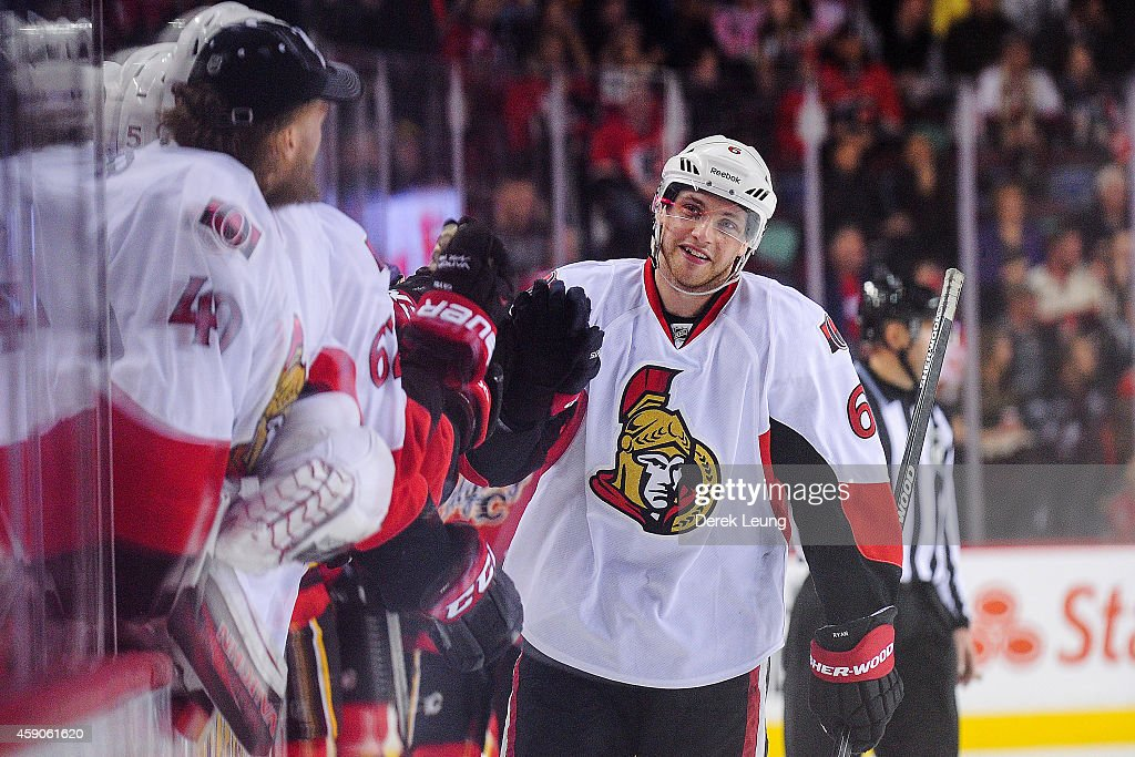 Bobby Ryan of the Ottawa Senators celebrates with the bench after scoring against the Calgary Flames during an NHL game at Scotiabank Saddledome on...
