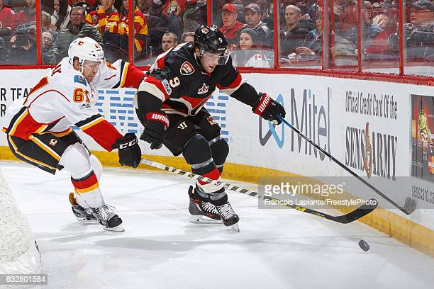 Bobby Ryan of the Ottawa Senators controls the puck against Brett Kulak of the Calgary Flames during an NHL game at Canadian Tire Centre on January...