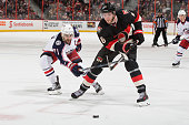 Bobby Ryan of the Ottawa Senators controls the puck as Nick Foligno of the Columbus Blue Jackets reaches with his stick to defend against at Canadian...