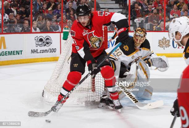 Bobby Ryan of the Ottawa Senators controls the puck in front of the net of Tuukka Rask of the Boston Bruins in Game Five of the Eastern Conference...