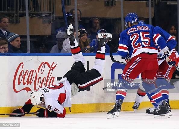 Bobby Ryan of the Ottawa Senators is tripped up during the second period aganst the New York Rangers at Madison Square Garden on December 6 2015 in...