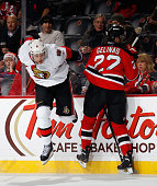 Bobby Ryan of the Ottawa Senators jumps to avoid a check by Eric Gelinas of the New Jersey Devils during the first period at the Prudential Center on...