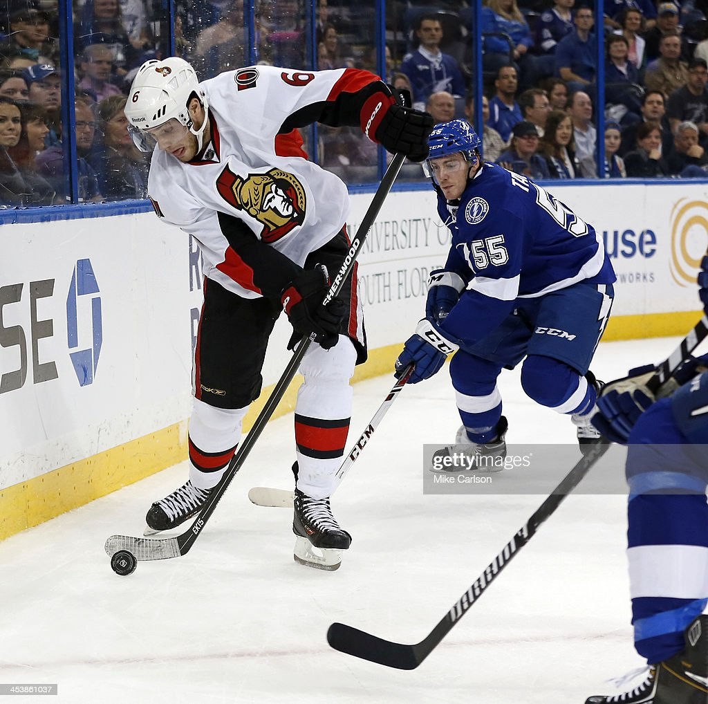 <a gi-track='captionPersonalityLinkClicked' href=/galleries/search?phrase=Bobby+Ryan+-+Ice+Hockey+Player&family=editorial&specificpeople=877359 ng-click='$event.stopPropagation()'>Bobby Ryan</a> #6 of the Ottawa Senators looks to avoid the check of <a gi-track='captionPersonalityLinkClicked' href=/galleries/search?phrase=Matt+Taormina&family=editorial&specificpeople=4008105 ng-click='$event.stopPropagation()'>Matt Taormina</a> #55 of the Tampa Bay Lightning at the Tampa Bay Times Forum on December 5, 2013 in Tampa, Florida.