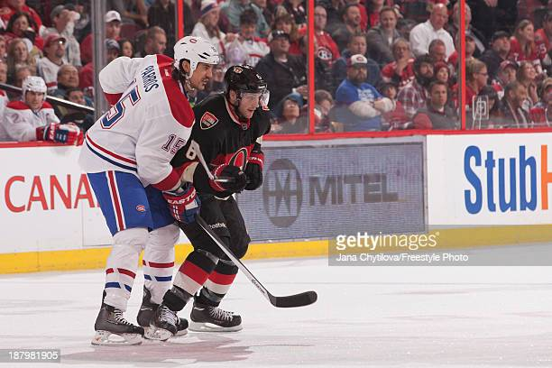 Bobby Ryan of the Ottawa Senators prepares for a faceoff against George Parros of the Montreal Canadiens during an NHL game at Canadian Tire Centre...