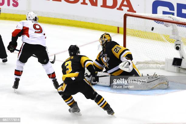 Bobby Ryan of the Ottawa Senators scores a goal against MarcAndre Fleury of the Pittsburgh Penguins in overtime of Game One of the Eastern Conference...