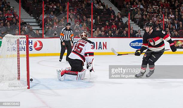 Bobby Ryan of the Ottawa Senators scores a shoot out goal against Cory Schneider of the New Jersey Devils at Canadian Tire Centre on October 22 2015...