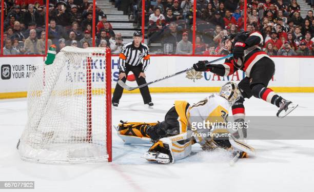 Bobby Ryan of the Ottawa Senators scores a shootout goal against Matt Murray of the Pittsburgh Penguins at Canadian Tire Centre on March 23 2017 in...