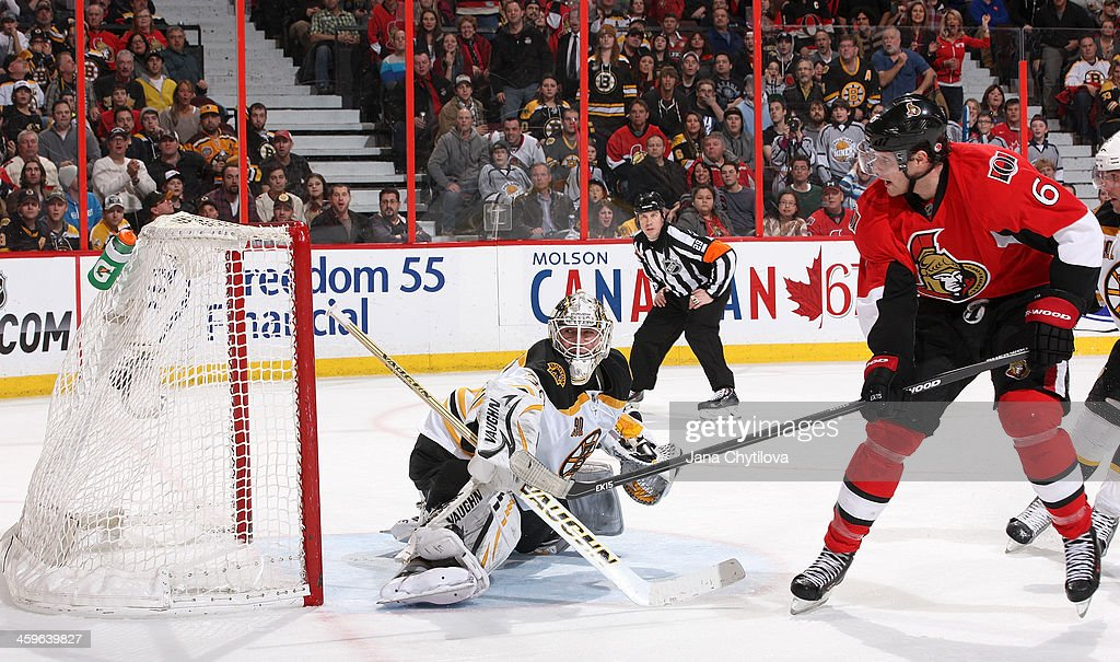 <a gi-track='captionPersonalityLinkClicked' href=/galleries/search?phrase=Bobby+Ryan+-+Ice+Hockey+Player&family=editorial&specificpeople=877359 ng-click='$event.stopPropagation()'>Bobby Ryan</a> #6 of the Ottawa Senators scores his game-winning third-period goal against Chad Johnson #30 of the Boston Bruins during an NHL game at Canadian Tire Centre on December 28, 2013 in Ottawa, Ontario, Canada.