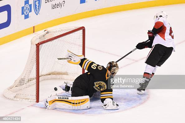 Bobby Ryan of the Ottawa Senators scores in a shoot out to win the game against Tuukka Rask of the Boston Bruins at the TD Garden on December 13 2014...
