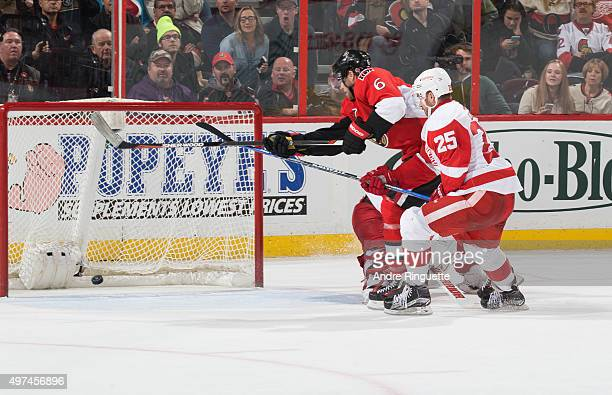 Bobby Ryan of the Ottawa Senators skates by Mike Green of the Detroit Red Wings scoring a late third period goal at Canadian Tire Centre on November...