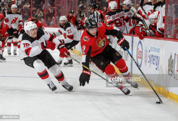 Bobby Ryan of the Ottawa Senators stickhandles the puck around Steven Santini of the New Jersey Devils at Canadian Tire Centre on October 19 2017 in...