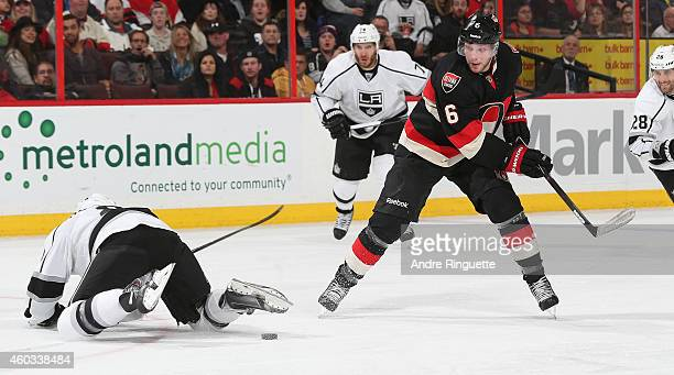 Bobby Ryan of the Ottawa Senators stickhandles the puck as Drew Doughty of the Los Angeles Kings falls to the ice at Canadian Tire Centre on December...