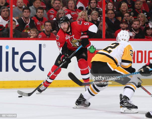 Bobby Ryan of the Ottawa Senators stickhandles the puck away from Mark Streit of the Pittsburgh Penguins in Game Six of the Eastern Conference Final...