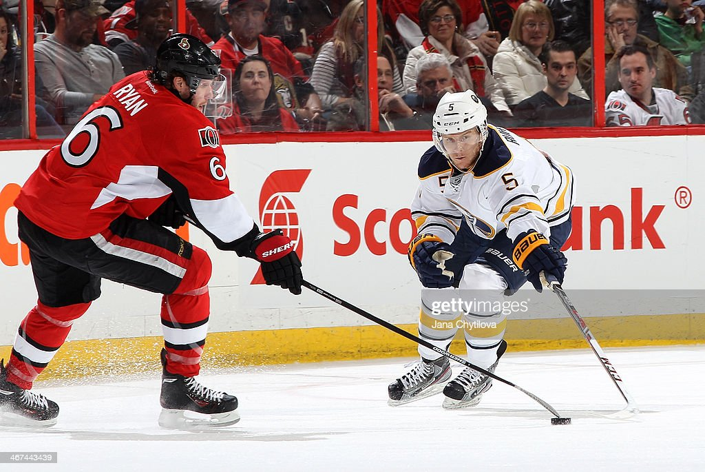 Bobby Ryan #6 of the Ottawa Senators tips the puck away from the outstretched stick of Chad Ruhwedel #5 of the Buffalo Sabres during an NHL game at Canadian Tire Centre on February 6, 2014 in Ottawa, Ontario, Canada.