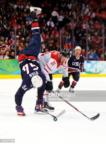 Bobby Ryan of the United States gets upended by Mathias Seger of Switzerland during the ice hockey men's quarter final game between USA and...