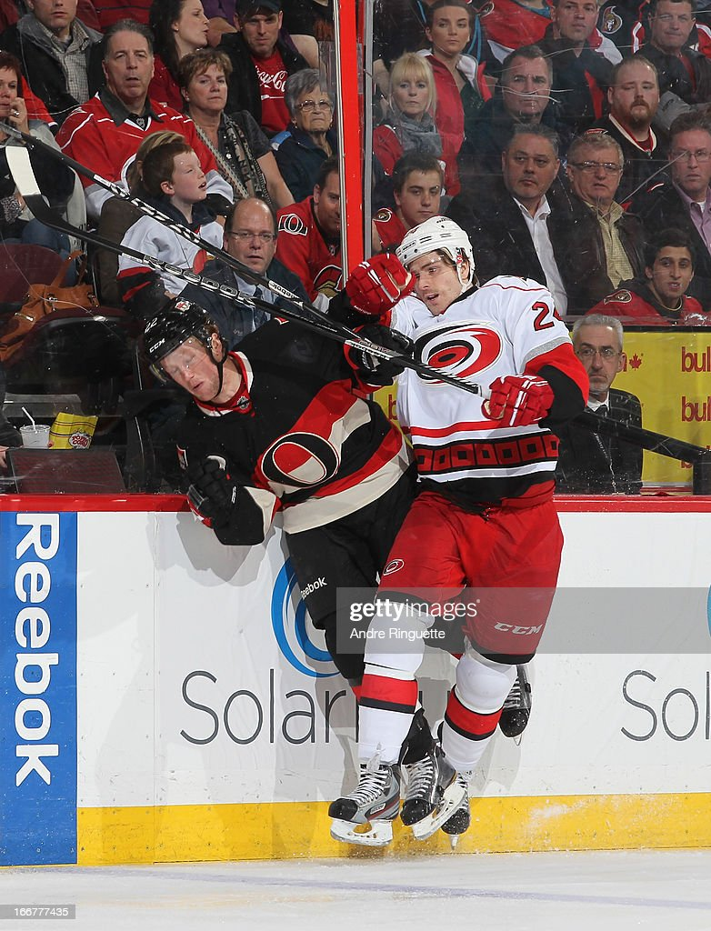Bobby Sanguinetti #24 of the Carolina Hurricanes body checks <a gi-track='captionPersonalityLinkClicked' href=/galleries/search?phrase=Erik+Condra&family=editorial&specificpeople=6254234 ng-click='$event.stopPropagation()'>Erik Condra</a> #22 of the Ottawa Senators into the boards on April 16, 2013 at Scotiabank Place in Ottawa, Ontario, Canada.