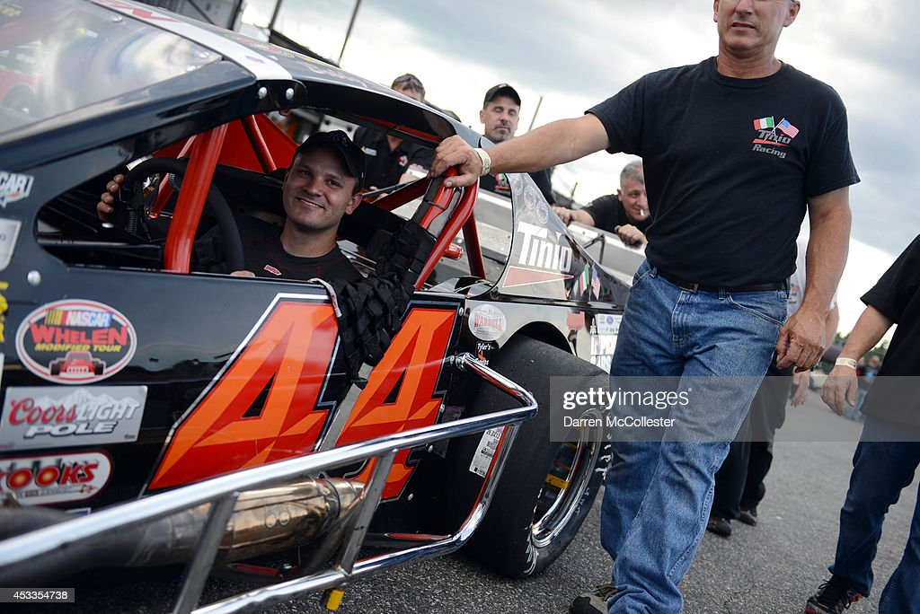 <a gi-track='captionPersonalityLinkClicked' href=/galleries/search?phrase=Bobby+Santos+-+Race+Car+Driver&family=editorial&specificpeople=4379746 ng-click='$event.stopPropagation()'>Bobby Santos</a> driver of the #44 Tinio Racing/ImperialCars.com Chevrolet prepares for qualifying at the Call Before You Dig 811 150 at Stafford Motor Speedway August 8, 2014 in Stafford, Connecticutt.