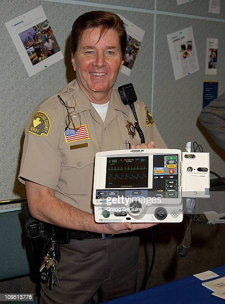 Bobby Sherman the 1970s teen heartthrob now a San Bernardino County deputy sheriff who has also worked as a paramedic and a CPR trainer holds a Life...