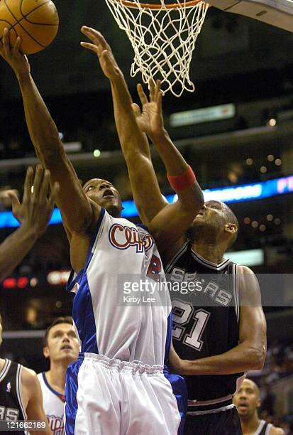Bobby Simmons of the Los Angeles Clippers drives to the basket against Tim Duncan of the San Antonio Spurs during 9879 loss to the San Antonio Spurs...