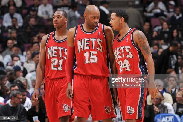 Bobby Simmons Vince Carter and Devin Harris of the New Jersey Nets walk on the court during the game against the Golden State Warriors on November 1...