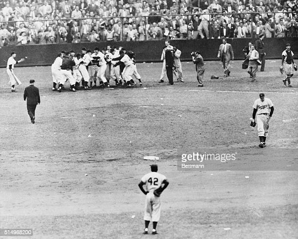 Bobby Thomson of the New York Giants is congratulated by his teammates after hitting a three run homer in last half of 9th inning of the 1951 playoff...