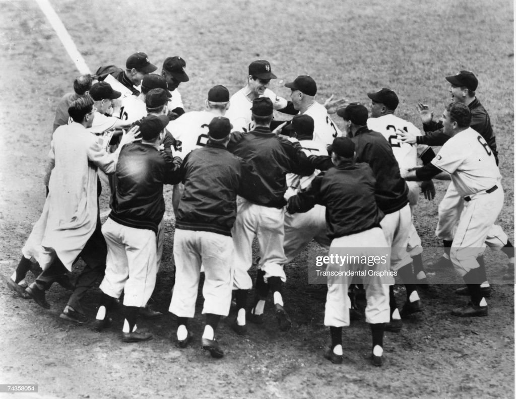 NEW YORK OCTOBER 1 1951 Bobby Thomson surrounded by New York Giant teammates touches home plate after his walk off home run defeated the Brooklyn...