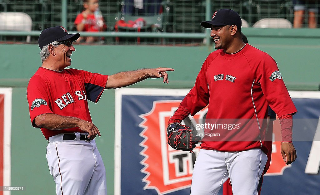 Bobby Valentine #25 of the Boston Red Sox laughs with Felix Doubront #61 of the Boston Red Sox during batting practice before a game with the Texas Rangers at Fenway Park August 7, 2012 in Boston, Massachusetts.
