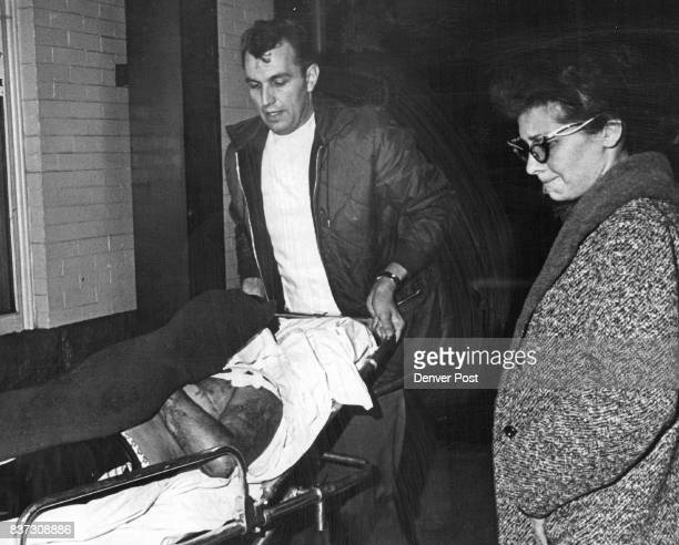 Bobby W Imoe Victim Of Shooting Thursday Is Taken To An Ambulance Watching is Mrs Alva Renee Myers 1617 Humboldt St Attendant is Erv Heiydt Youth...