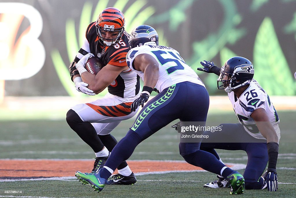 <a gi-track='captionPersonalityLinkClicked' href=/galleries/search?phrase=Bobby+Wagner+-+American+Football+Player&family=editorial&specificpeople=9205520 ng-click='$event.stopPropagation()'>Bobby Wagner</a> #54 of the Seattle Seahawks and <a gi-track='captionPersonalityLinkClicked' href=/galleries/search?phrase=Cary+Williams+-+American+Football+Player&family=editorial&specificpeople=10178470 ng-click='$event.stopPropagation()'>Cary Williams</a> #26 of the Seattle Seahawks attempt to tackle <a gi-track='captionPersonalityLinkClicked' href=/galleries/search?phrase=Tyler+Eifert&family=editorial&specificpeople=6258359 ng-click='$event.stopPropagation()'>Tyler Eifert</a> #85 of the Cincinnati Bengals during overtime at Paul Brown Stadium on October 11, 2015 in Cincinnati, Ohio. Cincinnati defeated Seattle 27-24 in overtime.