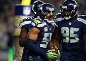 Bobby Wagner of the Seattle Seahawks celebrates with teammates in the end zone after recovering a fumble by Carson Palmer of the Arizona Cardinals...
