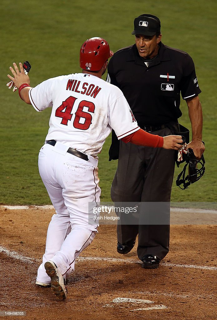 Bobby Wilson #46 of the Los Angeles Angels of Anaheim reacts after being called out attempting to steal home on a wild pitch against the Tampa Bay Rays at Angel Stadium of Anaheim on July 28, 2012 in Anaheim, California.