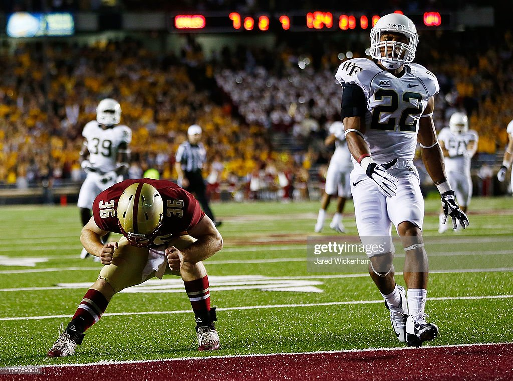 Bobby Wolford #36 of the Boston College Eagles reacts after missing a pass near the end zone in the first quarter in front of Ryan Janvion #22 of the Wake Forest Demon Deacons during the game on September 6, 2013 at Alumni Stadium in Chestnut Hill, Massachusetts.