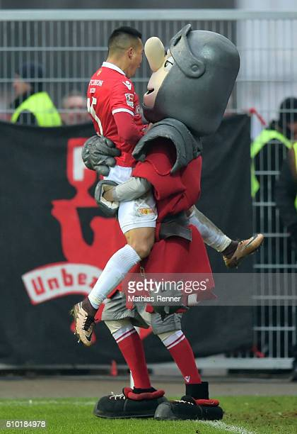 Bobby Wood and mascot Ritter Keule of 1 FC Union Berlin celebrate during the game between Union Berlin and TSV 1860 Muenchen on february 14 2016 in...