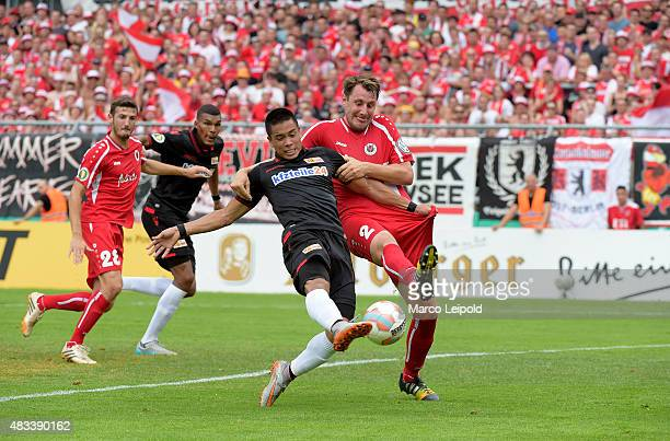 Bobby Wood of 1 FC Union Berlin and Markus Brzenska of FC Viktoria Koeln during the match between FC Viktoria Koeln and Union Berlin on August 8 2015...
