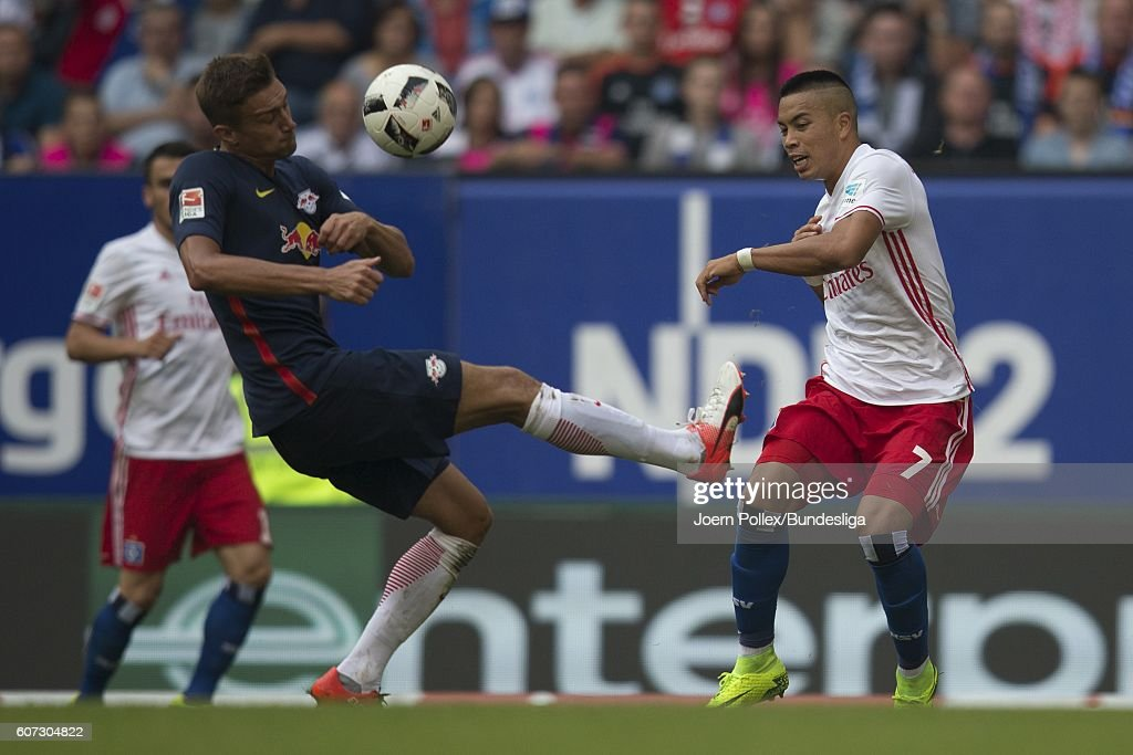 Bobby Wood of Hamburg and Stefan Ilsanker of Leipzig compete for the ball during the Bundesliga match between Hamburger SV and RB Leipzig at Volksparkstadion on September 17, 2016 in Hamburg, Germany.