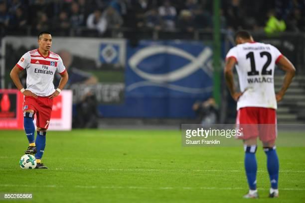 Bobby Wood of Hamburg and Walace of Hamburg look dejected after Dortmund scored their third goal the Bundesliga match between Hamburger SV and...
