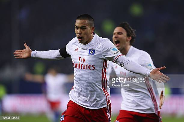 Bobby Wood of Hamburg celebrates with teammates after scores his team's first goal during the Bundesliga match between Hamburger SV and FC Schalke 04...