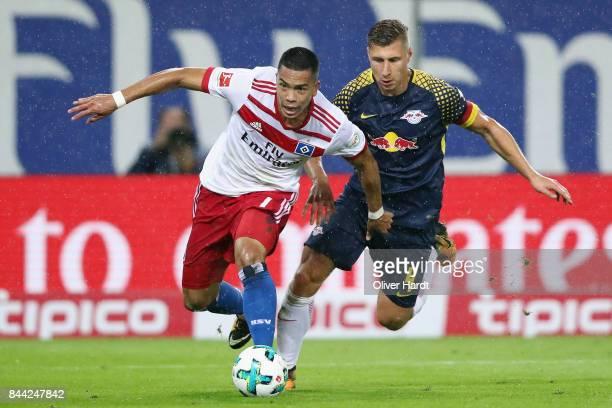 Bobby Wood of Hamburg eludes Willi Orban of Leipzig during the Bundesliga match between Hamburger SV and RB Leipzig at Volksparkstadion on September...