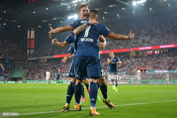 Bobby Wood of Hamburg is being celebrated by Andre Hahn of Hamburg after he scored Hamburg's second goal during the Bundesliga match between 1 FC...