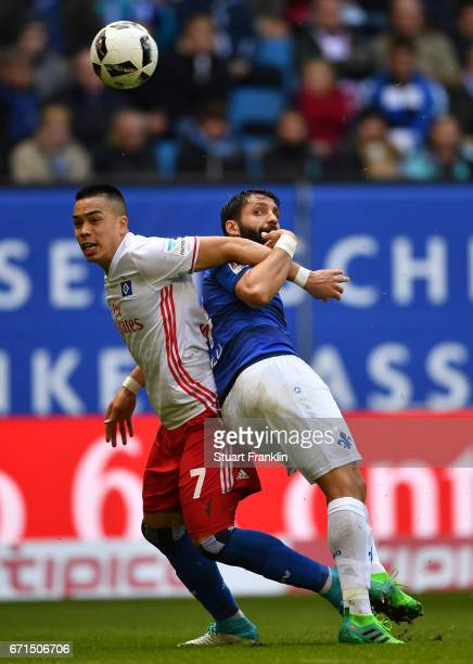 Bobby Wood of Hamburg is challenged by Aytac Sulu of Darmstadt during the Bundesliga match between Hamburger SV and SV Darmstadt 98 at...