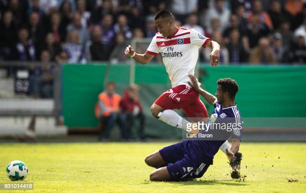 Bobby Wood of Hamburg is challenged by Marcel Appiah of Osnabrueck during the DFB Cup match between VfL Osnabrueck and Hamburger SV at Osnatel Arena...